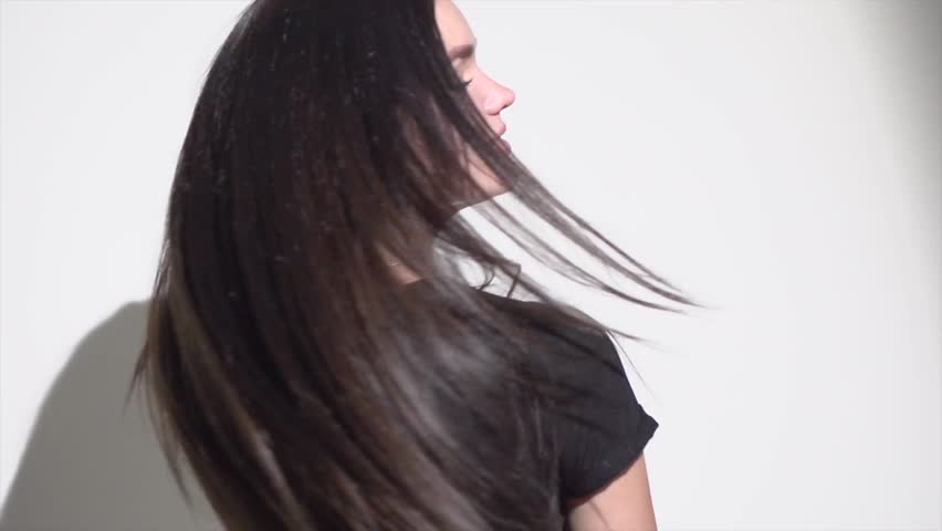 Beautiful long Hair. Beauty woman with luxurious straight black hair. Sexy brunette Model girl with Healthy Hair. Lady with long smooth shiny straight hair. 4K slow motion