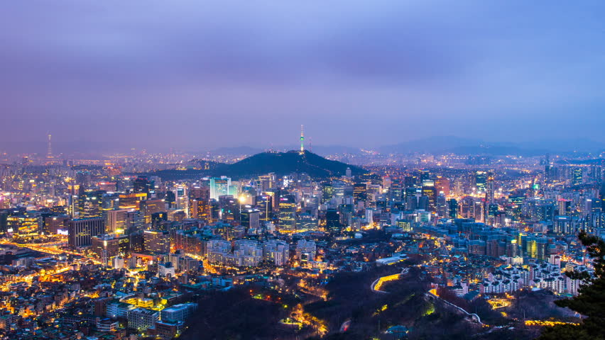Time lapse day to night skyline of Seoul with Seoul tower, South Korea. Zoom in.   Shutterstock HD Video #29379103
