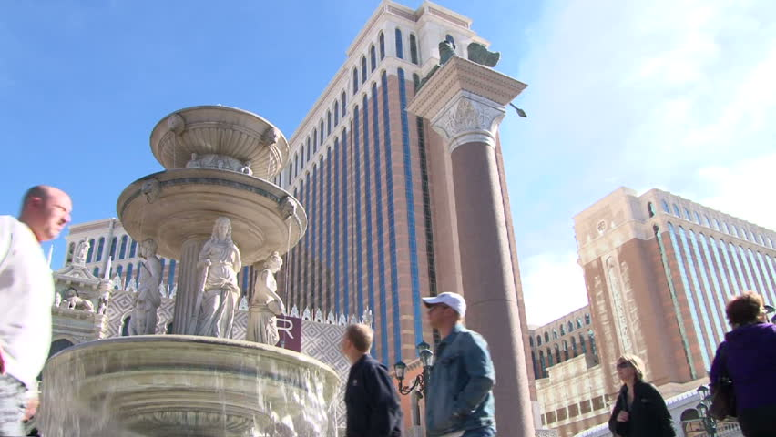 LAS VEGAS, NEVADA - CIRCA 2012 - Las Vegas Boulevard Strip and the Venetian Hotel and Casino with people walking by on sunny day.