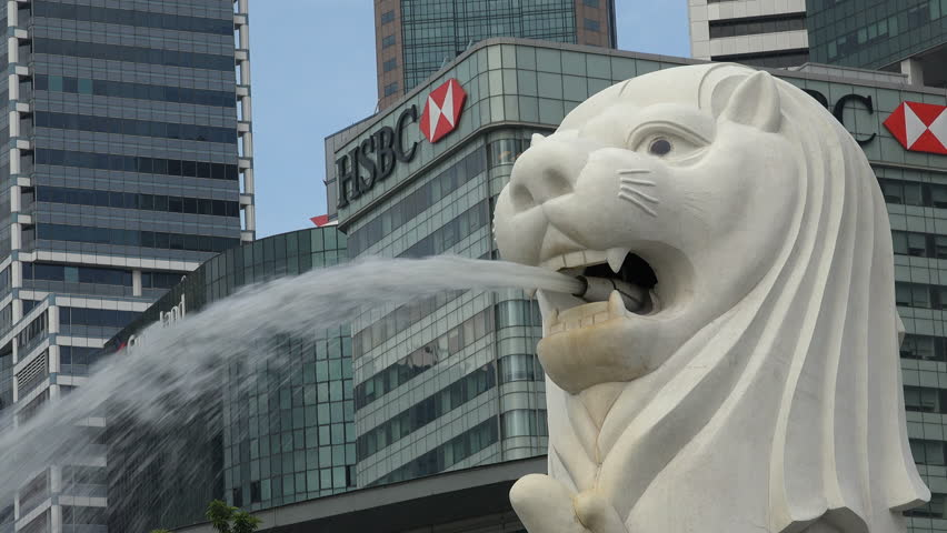 SINGAPORE - MAY 2017: Closeup of the iconic Merlion statue in front of HSBC branch office tower in Singapore financial and business district