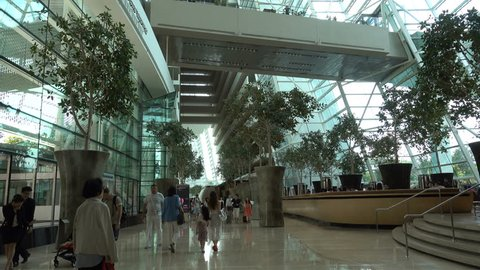 SINGAPORE - MAY 2017: People walk through futuristic hotel lobby of Marina Sands Bay resort in Singapore