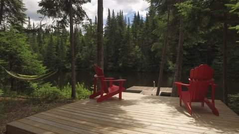 muskoka cottage chairs at river dock smooth approach gimbal