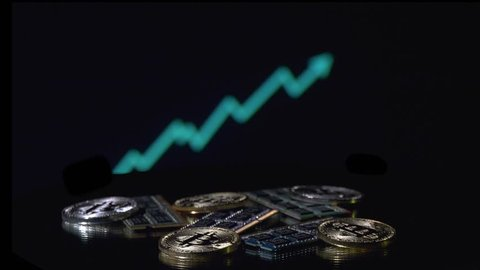 Bitcoin cryptocurrency BTC and computer components rotating in front of growth graph animated background