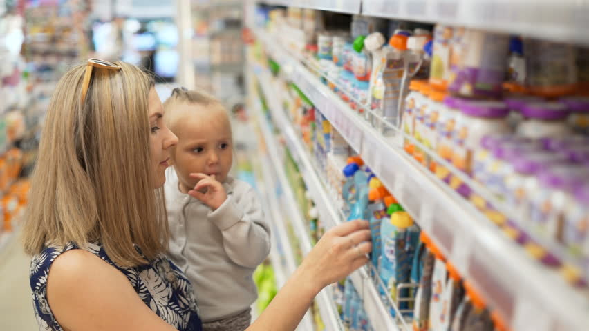 Beautiful Woman With Baby Daughter Shopping In Supermarket
