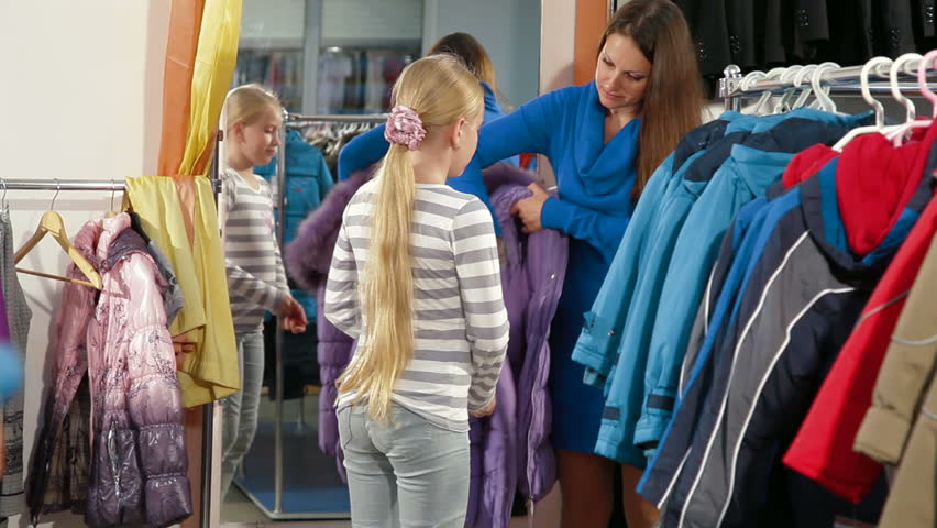 Family Shopping For Girls Clothes In Clothing Store Stock Footage ...