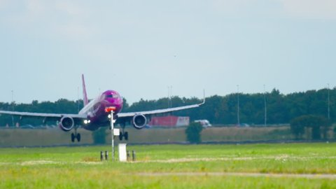 AMSTERDAM, THE NETHERLANDS - JULY 26, 2017: WOW Air Airbus 321 TF-JOY landing on runway 18R Polderbaan. Shiphol Airport, Amsterdam, Holland