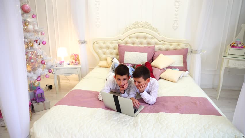 Lovely Children Brothers Look At Camera With Smile Laugh And Computer Screen