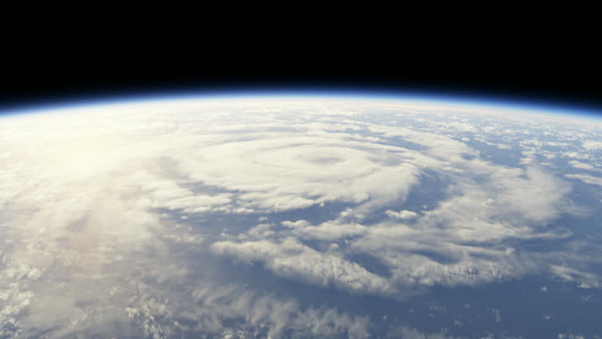 Hurricane seen from space, flying into storm