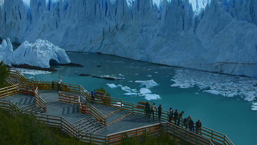 Some tourists look the Perito Moreno Glacier