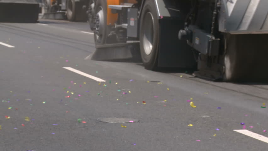 Street Sweepers Clean Confetti. Street sweepers drive down Figueroa and clean up the street following the 2010 LA Lakers Championship parade on June 21st, 2010, Los Angeles, California.