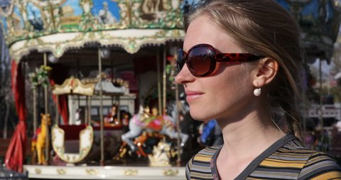 Smiling Woman Enjoy Looking At Funny Carousel Motion In Park, Childhood Fun Place