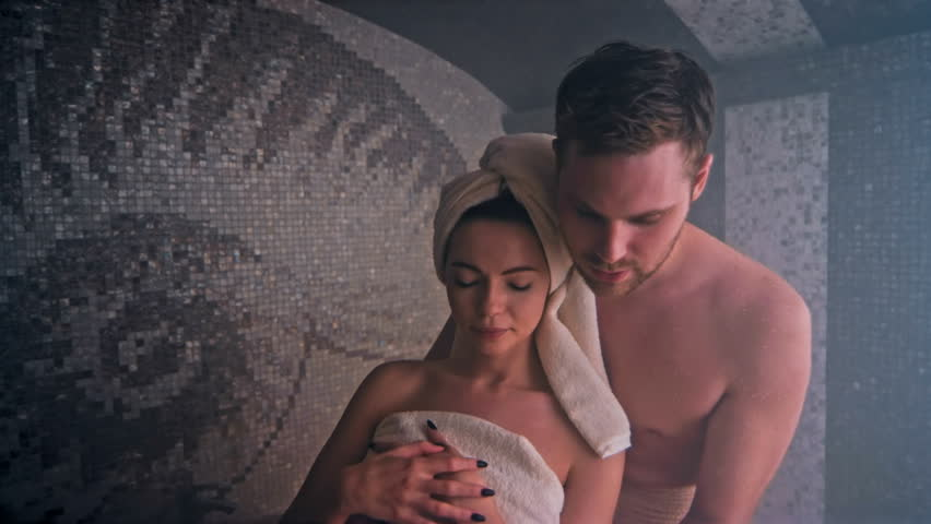Happy couple enjoying in sauna together at the spa. Shot in Red Epic Dragon