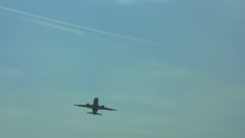 Tracking shot of airplane climbing in sky after takeoff HD 1080p | Shutterstock HD Video #2967775