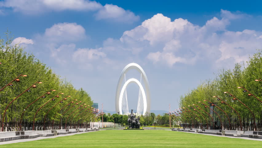 Time lapse of cityscape in nanjing city, landmark nanjing eye bridge cloudy day, china
