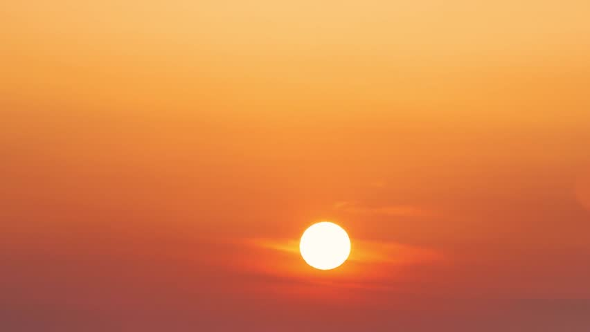 SUNRISE WITH CLEAR ORANGE COLOR SKY, MORNING STARTUP. Brilliant summit dawn above flowing cloud waves, red sun disk time lapse, Big Sunrise Close-up, Sun Rising at Dawn Time Lapse.
