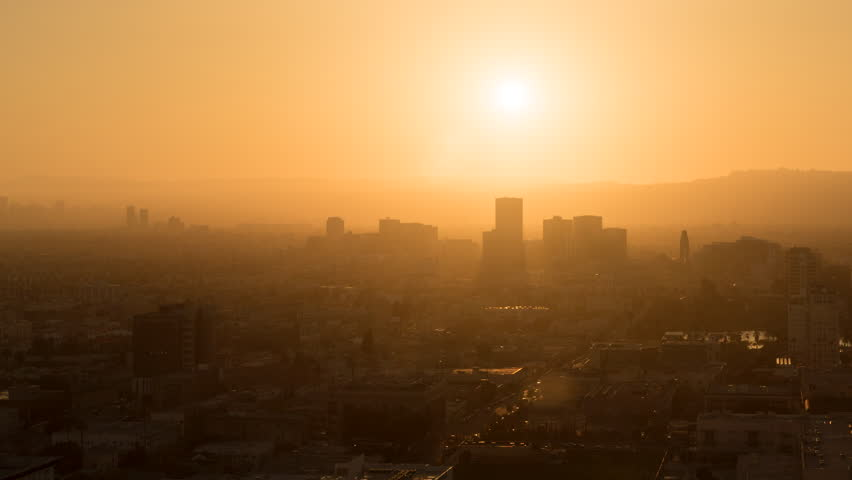 Los angeles smog downtown metropolitan city haze sunlight time lapse sun setting behind the mountains behind century city hollywood and the west side sciox Gallery