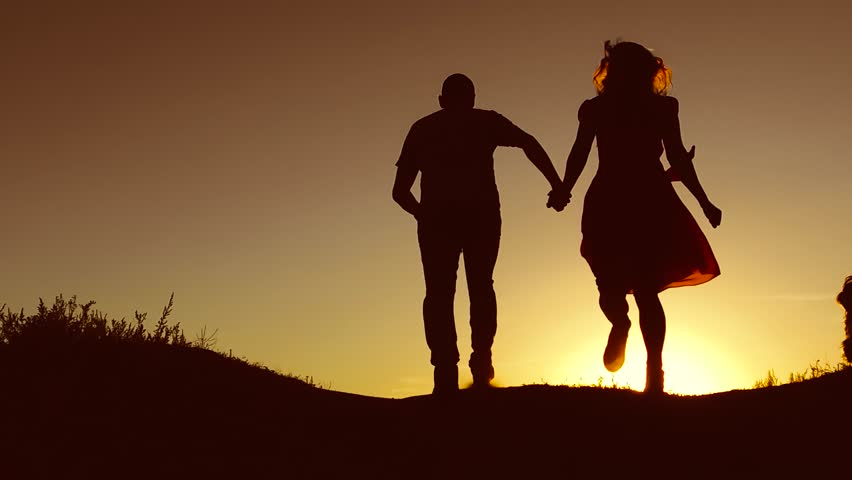 Man and woman couple in love silhouette jumping in slow motion video. Man and woman joy running and jumping on nature sunlight silhouette slow motion video | Shutterstock HD Video #29776795
