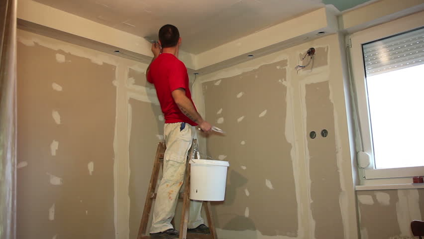 High Quality Applying Plaster To Plasterboard. Painting Contractor At Work   Interior  Decoration. Craftsman Arranging An