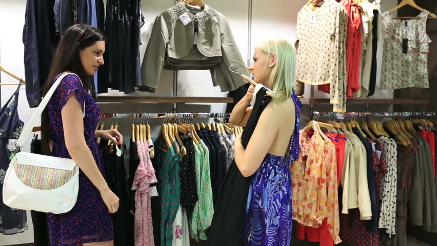 f5d20d591f3 Women looking at dresses in clothing store. w. By wavebreakmedia. Stock  footage ...