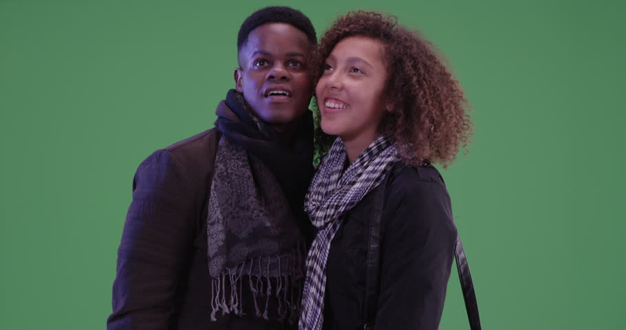 Young black man and woman explore on green screen. On green screen to be keyed or composited. #29820925