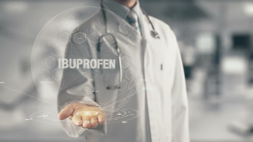 Doctor holding in hand Ibuprofen