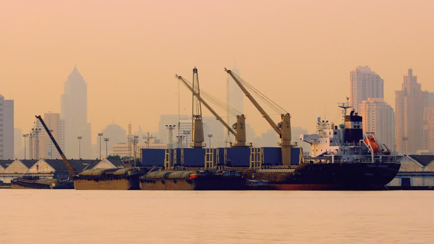 Container Cargo freight ship with working crane bridge in shipyard at evening for Logistic Import Export background   Shutterstock HD Video #2983555