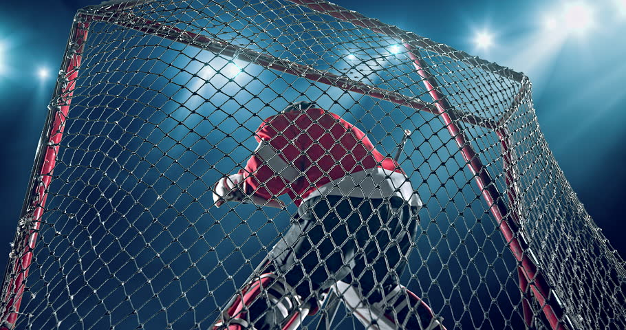 Ice Hockey goalie fails a goal on a dark background with intensional lens flares. He is wearing unbranded sports clothes. | Shutterstock Video #29841055