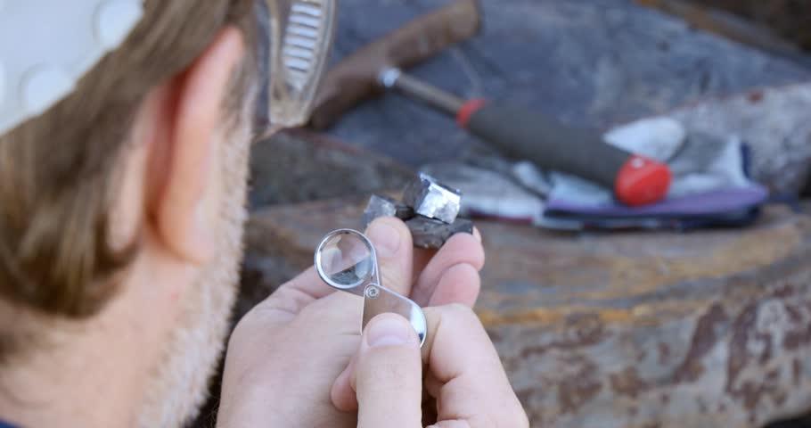 Mining prospect mineral exploration Geologist taking field rock data sample | Shutterstock HD Video #29892355