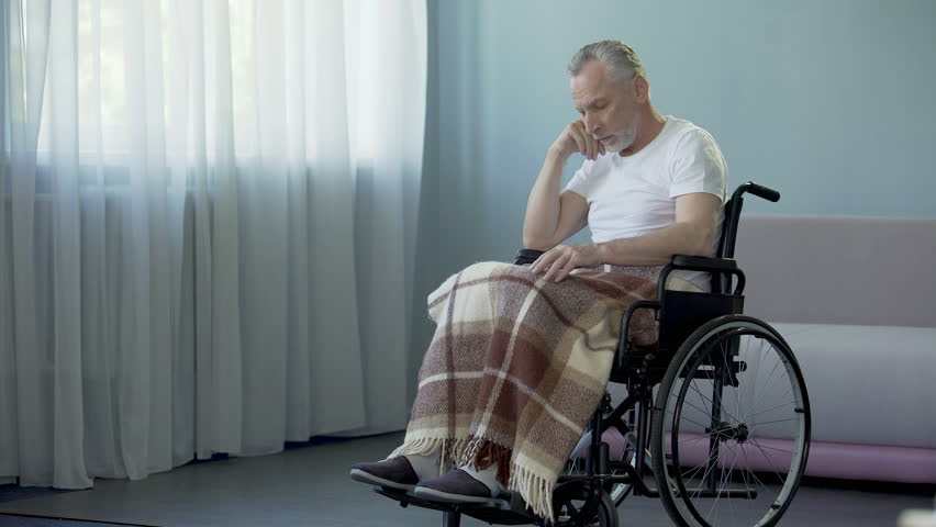 Sad Sorrowful Lonely Old Man Sitting In Wheelchair In His
