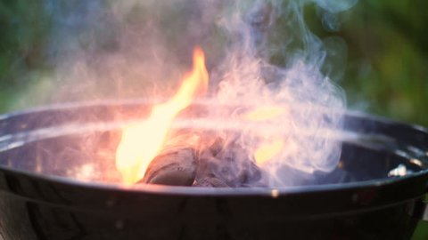 Embers that burn in a barbecue, slow motion