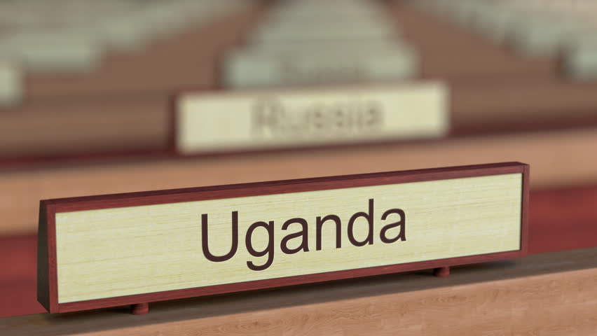 Uganda name sign among different countries plaques at international organization. 3D rendering