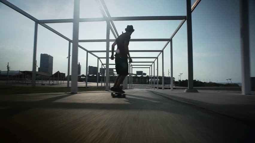 cool guy on his longboard  skate in a great park en Barcelona, Spain.