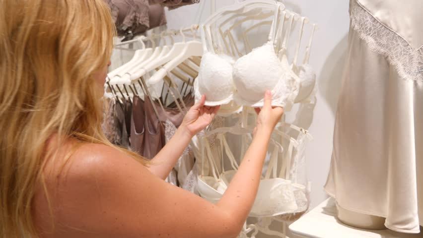 12fee43fa Shop of women s underwear. Women s panties on hangers in a sex store