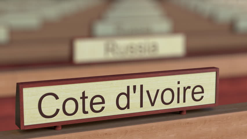 Cote d'Ivoire name sign among different countries plaques at international organization. 3D rendering