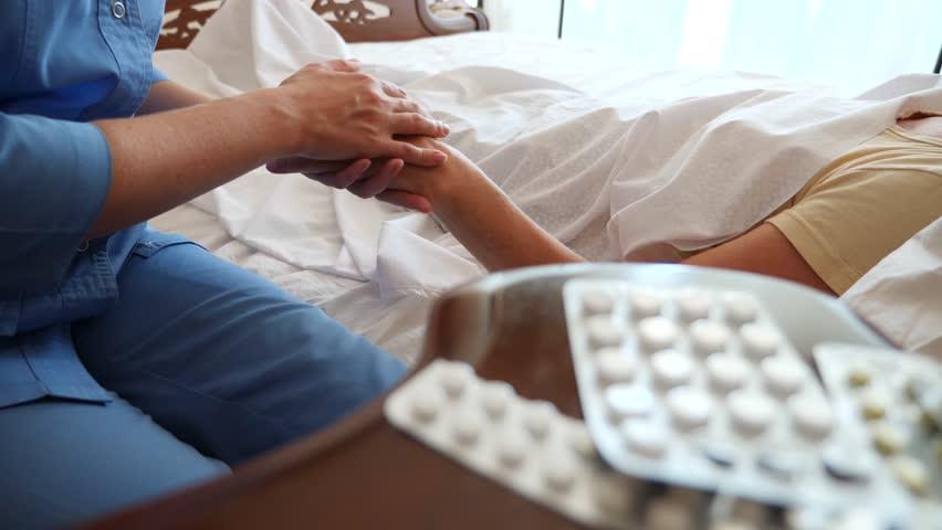 A nurse helps a patient in his bedroom. 4k, slow motion | Shutterstock HD Video #29961058