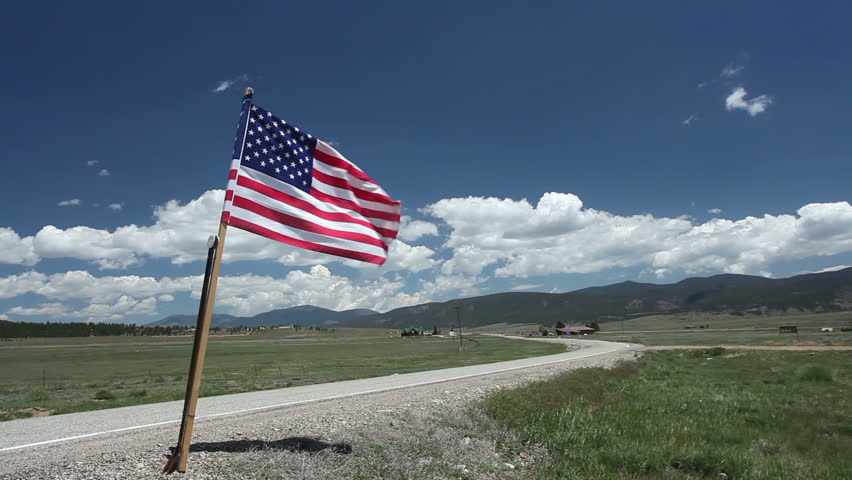 American flag on a scenic stretch of highway in New Mexico. HD 1080p.