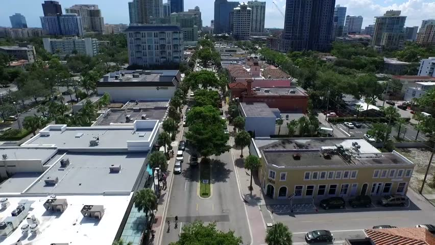 Beautiful aerial 4k drone view on calm street road in downtown modern architecture tall buildings of Florida cityscape