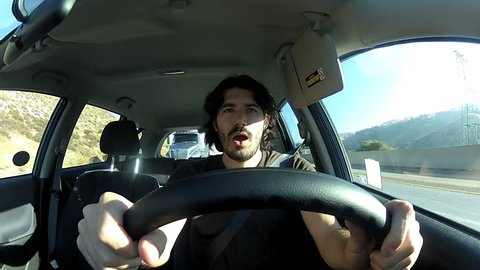 Tired young driver yawning