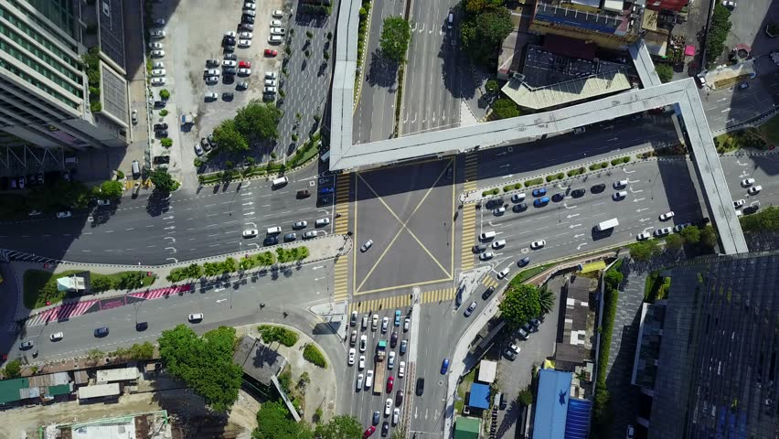 Zoom in tilt down traffic four junction ampang park during sunny day business area busy kuala lumpur malaysia 4K resolution Ultra HD | Shutterstock HD Video #29980075