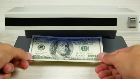 One hundred dollars in the detector look like a one-dollar bill. Detection of counterfeit money.