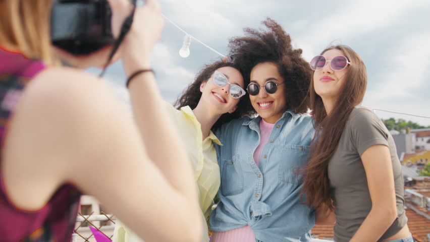 Diverse Young Party Girls On Rooftop Posing As Young Female Photographer Takes Pictures Of Them Fashion Photography Happy Music Celebration Occasion Of Friendship Photoshoot Carefree Friendship