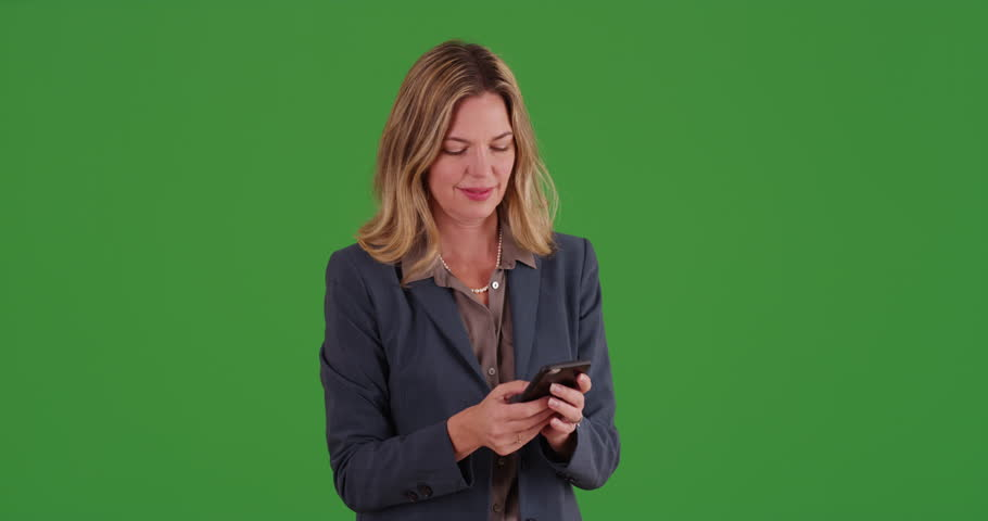 Middle aged adult Caucasian business woman talking on smartphone on green screen. On green screen to be keyed or composited. | Shutterstock HD Video #30032455