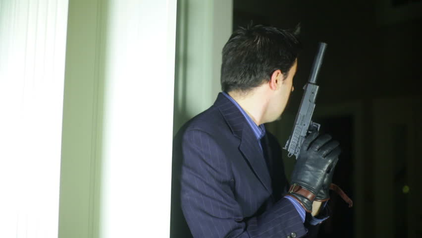 A secret agent with a silencer gun