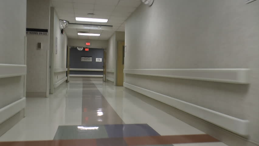 Hospital visitor, POV, walks through halls, follows signs to dining room. 1080p