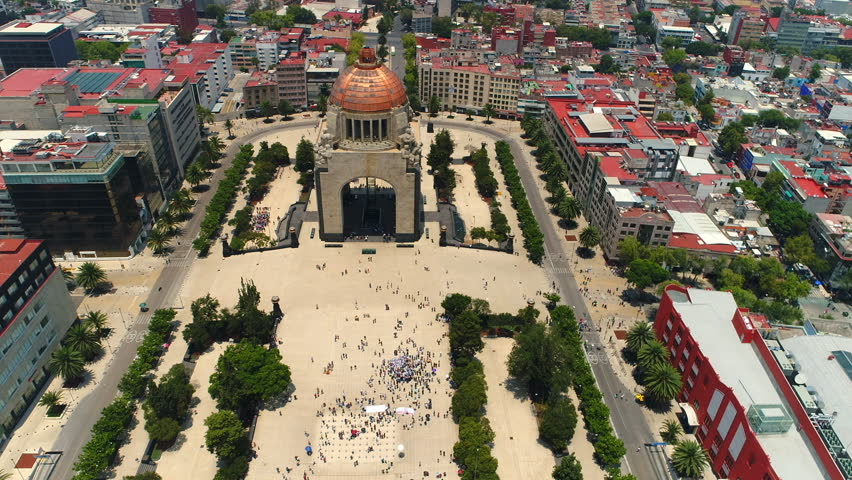 Aerial view of Monument to the Mexican Revolution (Monumento a la Revolución Mexicana), Republic Square (Plaza de la República), Mexico City from above, 4k UHD