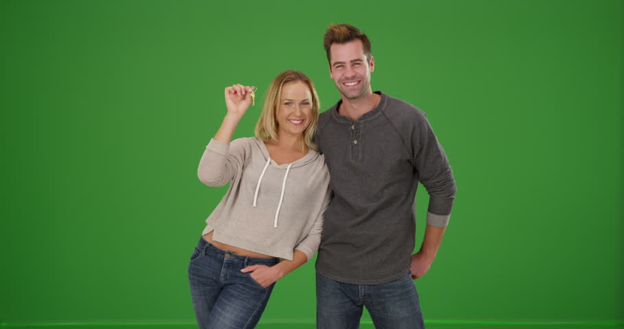 Excited first time homebuyers on green screen. On green screen to be keyed or composited. #30068875
