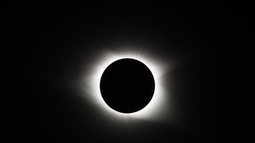 The Sun's corona is visible during the total eclipse phase of the Great American Eclipse on August 21, 2017.  Pinkish solar flares are also visible near the Sun's surface. #30076030