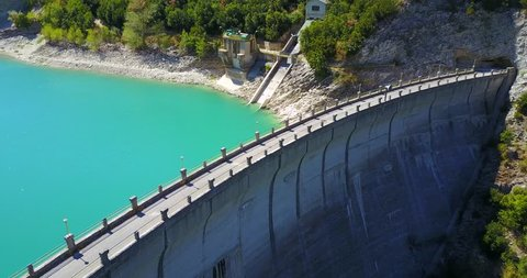 AERIAL: Cinematic view of Fiastra lake dam. Marche Region, Italy.