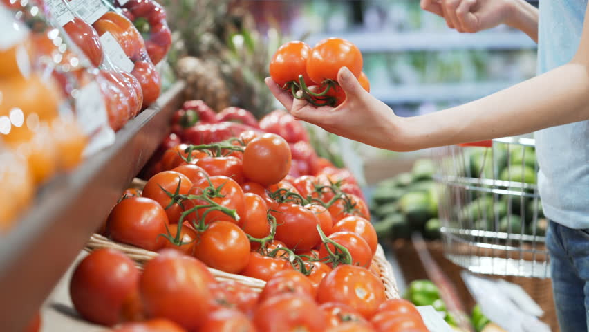 Woman's white hands take few colorful tomatoes in marketplace and hold. Closeup concept of selection and buying fruit or red vegetable. Young girl pick up some tasty freshness ingredient for cooking | Shutterstock HD Video #30103975