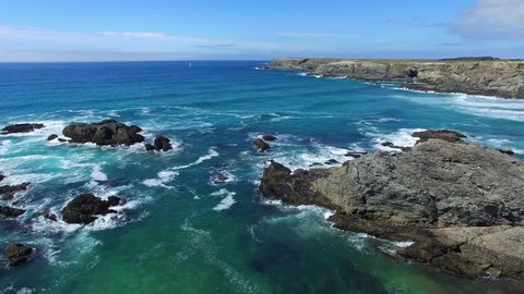 """Flying over the beach of """"Port-Donnant"""", famous surf spot with consistent waves, located on the east coast of the island of Belle-ile-en-Mer, the largest of Morbihan islands, Brittany, France."""